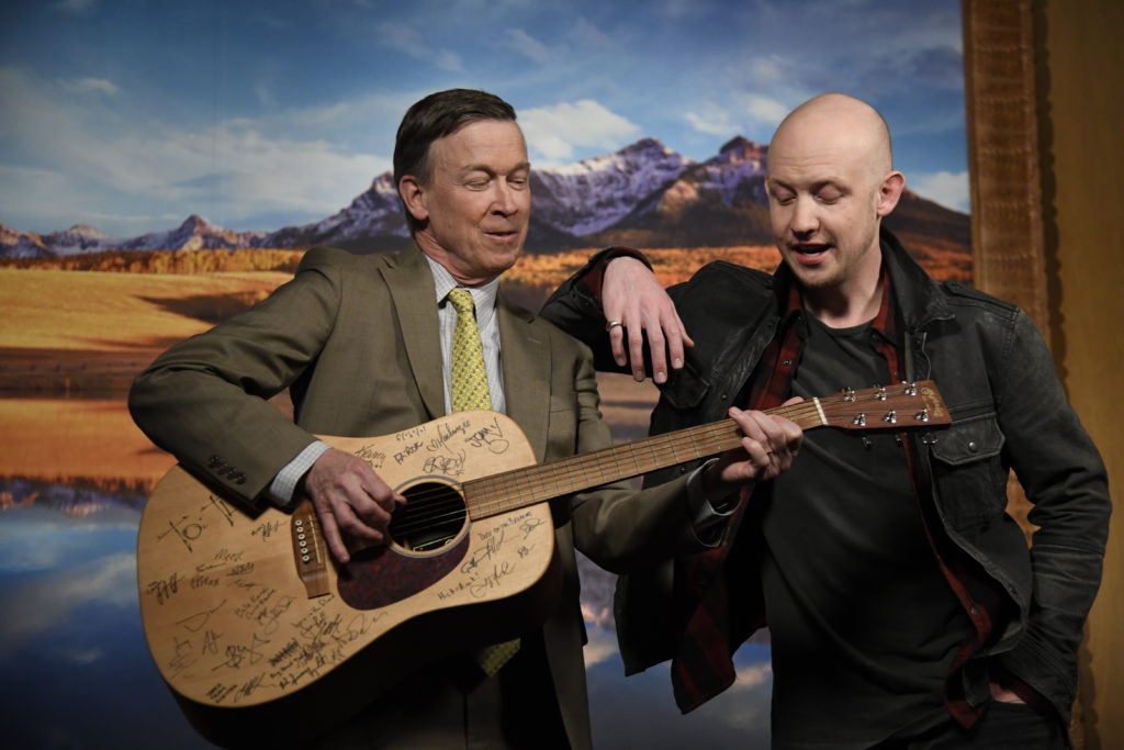 Isaac Slade leans on Governor Hickenlooper as he plays a little tune on his guitar after their PSA shoot. An exclusive on a new Colorado music foundation, an education-focused nonprofit with a powerful board of directors and the backing of Governor Hickenlooper, AEG Live Rocky Mountains and the Anschutz family, that's looking to bring more music to schools amid budget cuts for music and the arts in general. Governor Hickenlooper and Isaac Slade (The Fray) shoot a PSA to announce the foundation March 6, 2017 in Denver, Colorado at the Governors office.